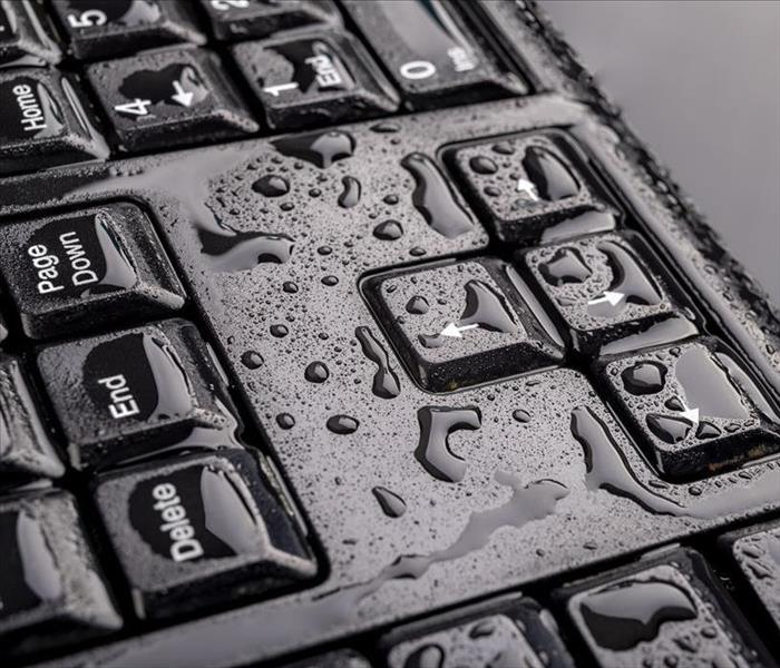 keyboard with water on it